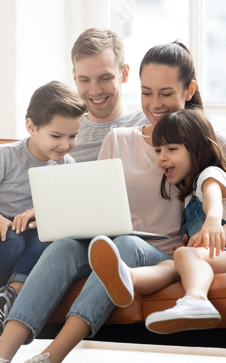 family looking at laptop