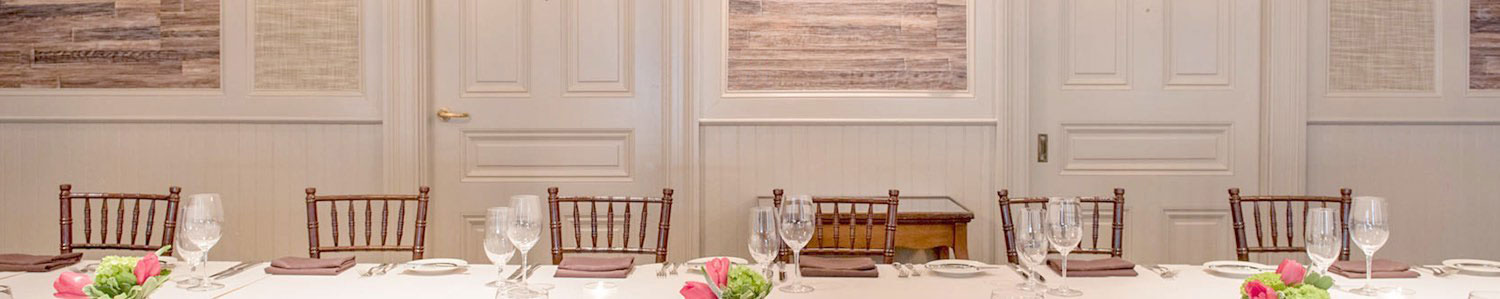 Room with long rectangular table set for meal
