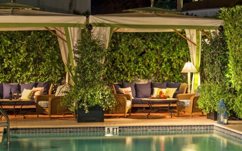 cabanas at night by the pool