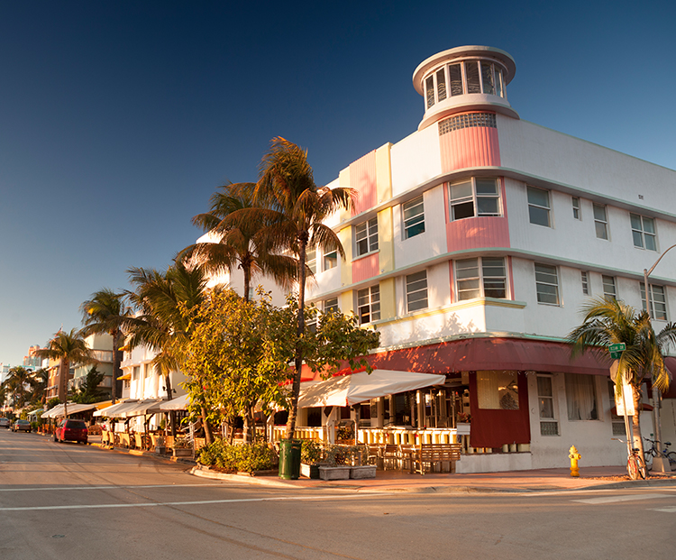 Miami Beach white and pink art deco building on the corner of a street