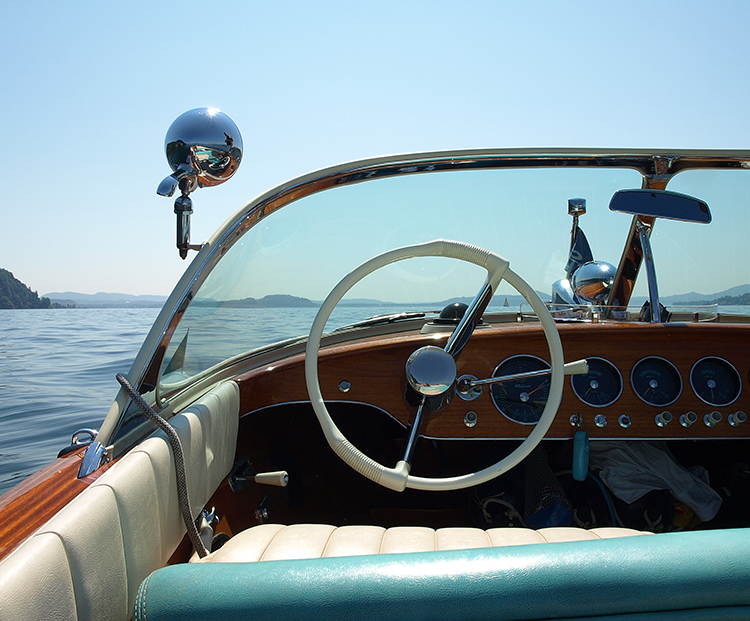 vintage boat cruising on the water