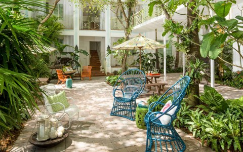 wundergarden courtyard of colorful seating surrounded by lush plants