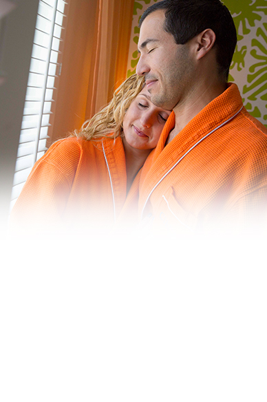 man and woman embracing wearing orange bat robes