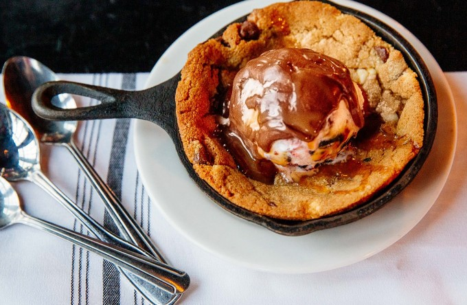 an apple cobbler served in a cast iron pan