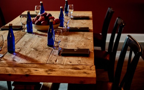 wooden dinning  table with wine glasses