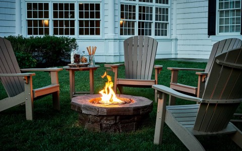 colgate inn patio with lawn chairs and fireplace hero