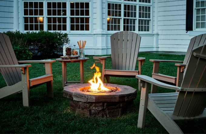 lawn chairs around a fire pit
