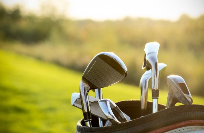 a bag with golf clubs on the course
