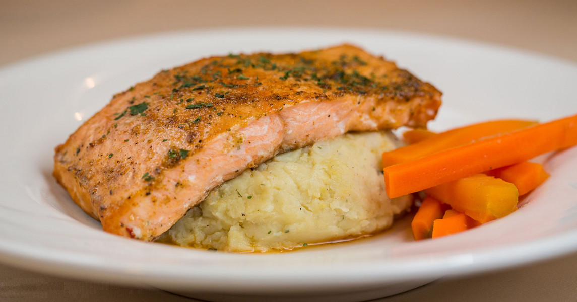 Salmon over rice with carrots