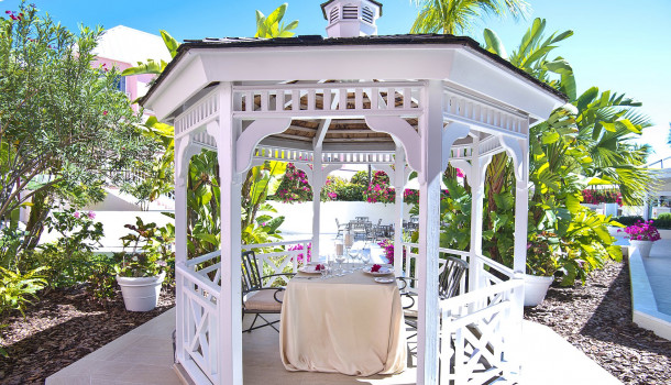 Outdoor cabana with private dining setup