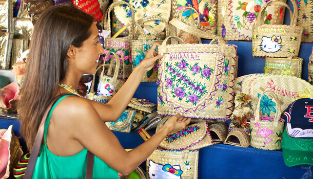 Woman shopping at Nassau Market through artisanal bags