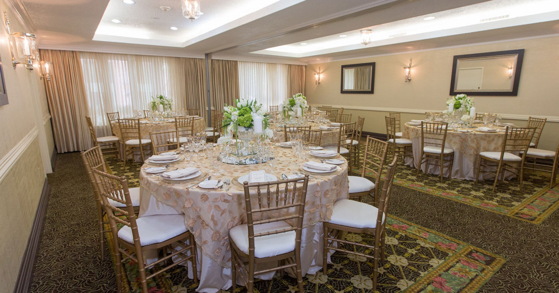 Round tables set up with white chairs