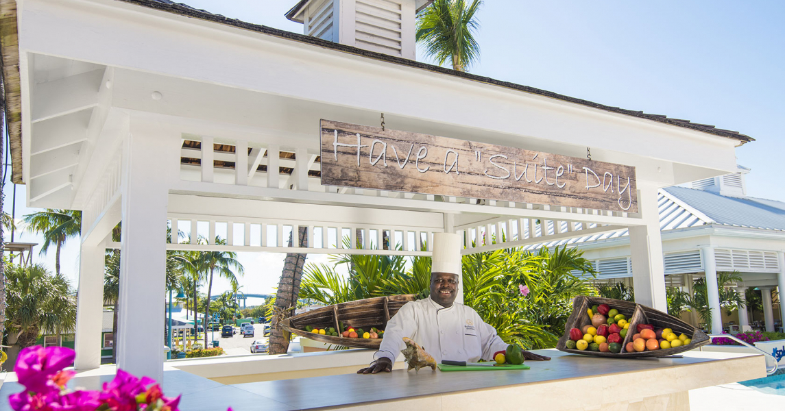 Chef standing behind counter at pool bar