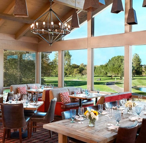 inside dining area with large windows overlooking the golf course