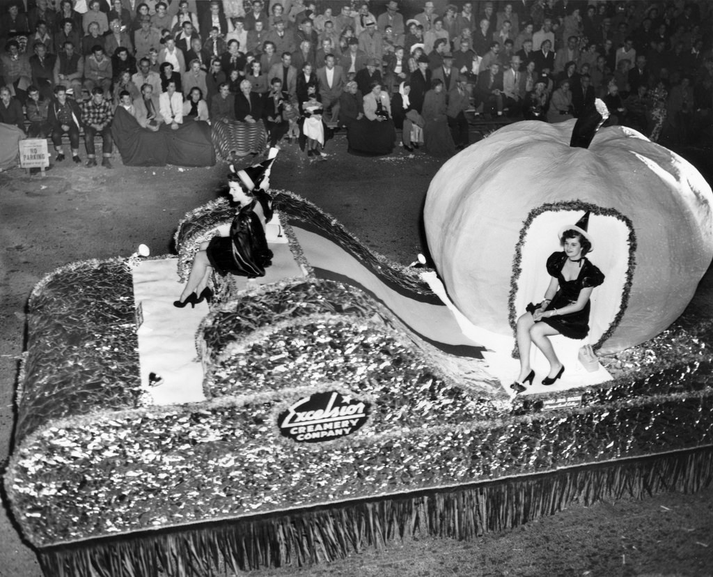 Parade float with woman sitting in a pumpkin