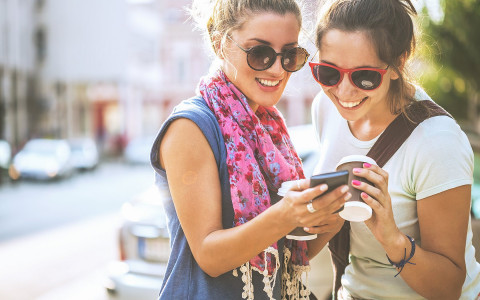 Two women looking at a smart phone