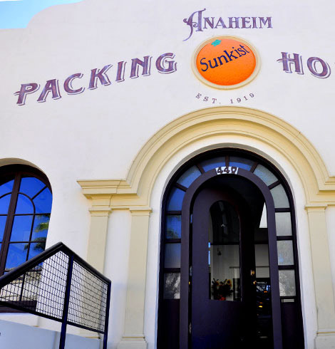 Building entrance with Anaheim Packing House wording above the door