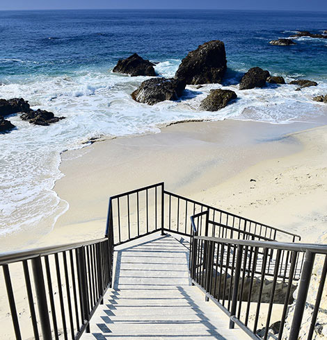 Staircase leading down to a beach