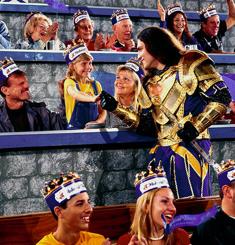 Man and crowd at Medieval Times dinner theater