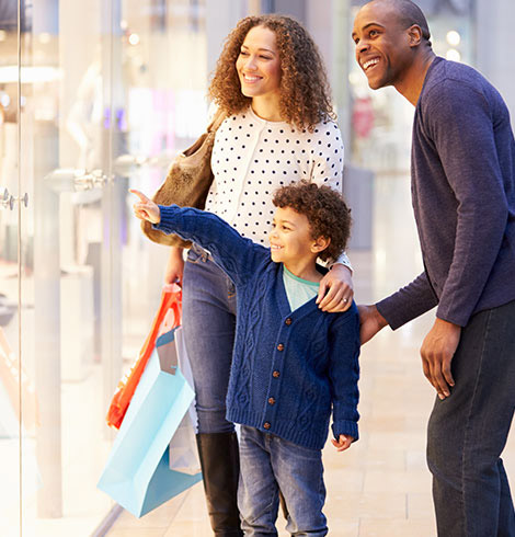 Man and woman shopping with their son