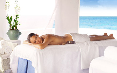 woman laying on a spa table