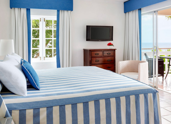 guest room with blue and white stripped bed