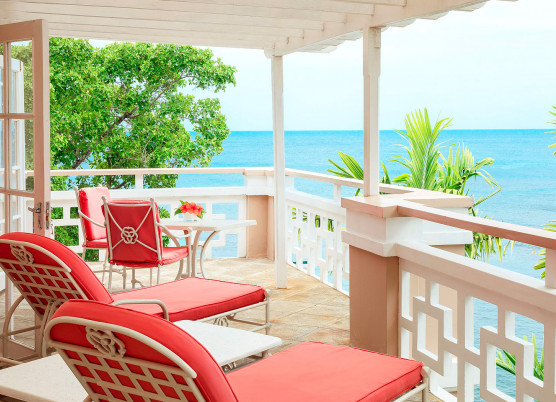 penthouse suite with coral balcony porch furniture overlooking blue water