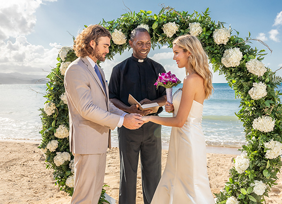 a pastor marrying a couple on the beach