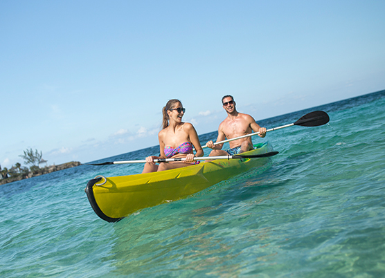 Couple Kayaking in the ocean