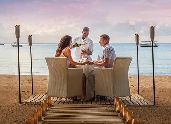 couple having a private dinner on the beach