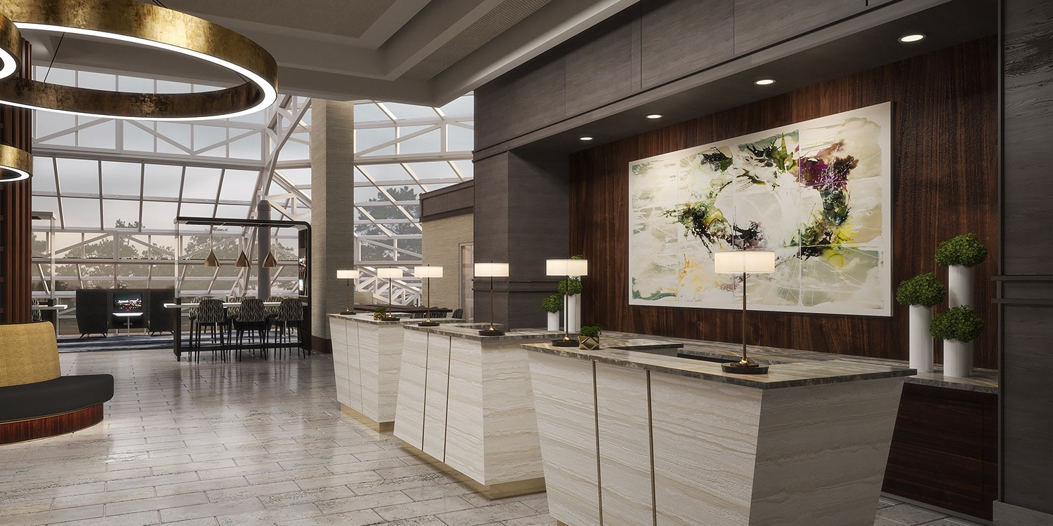 hotel lobby check in desks with a modern painting behind the desks and a large rounded light fixture