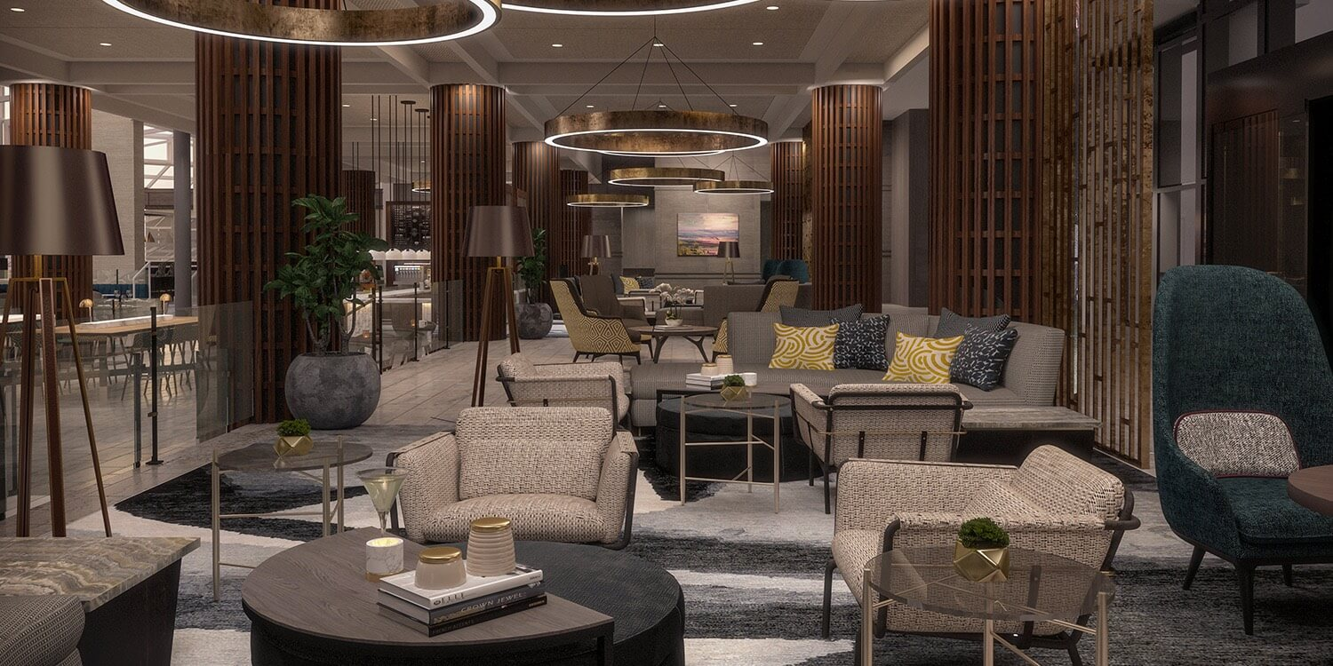 comfortable lobby seating area with chairs, couches, and modern circular light fixtures