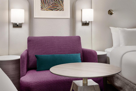 seating nook with a purple couch and round table