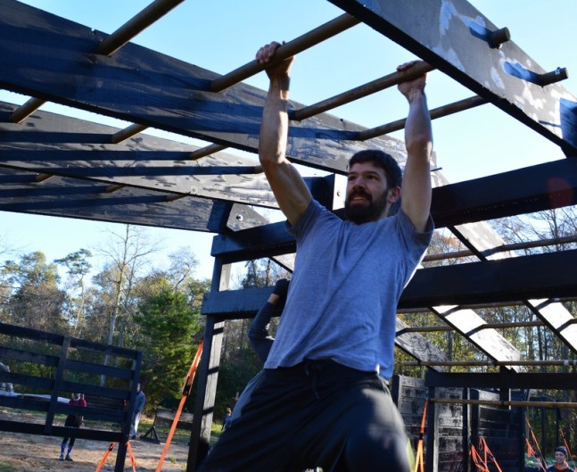 Man swinging on monkey bars