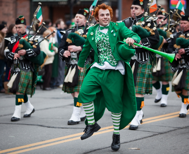 Saint Patricks Day Bagpipe Band with Leprecaun Costumed Marcher