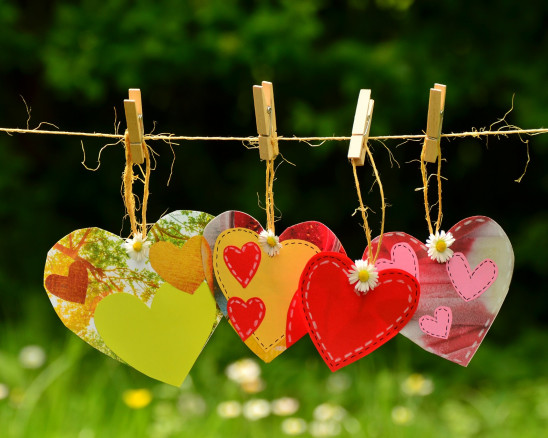 paper folk art hearts clotheslined on rope