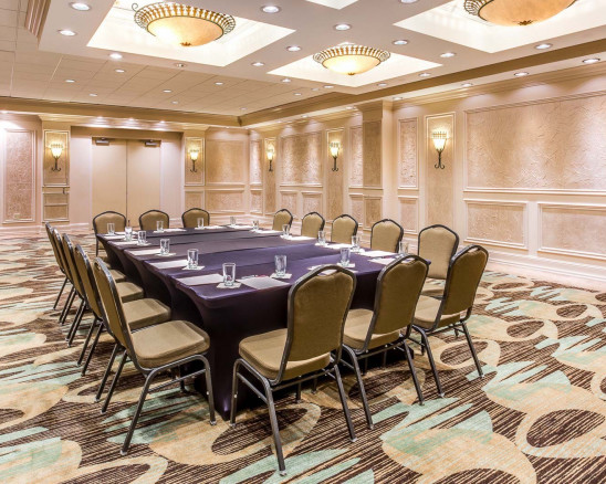 A spacious and elegant room with a large private table