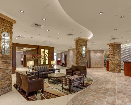 Crowne Plaza Baton Rouge interior brick columns and stone tiled floors