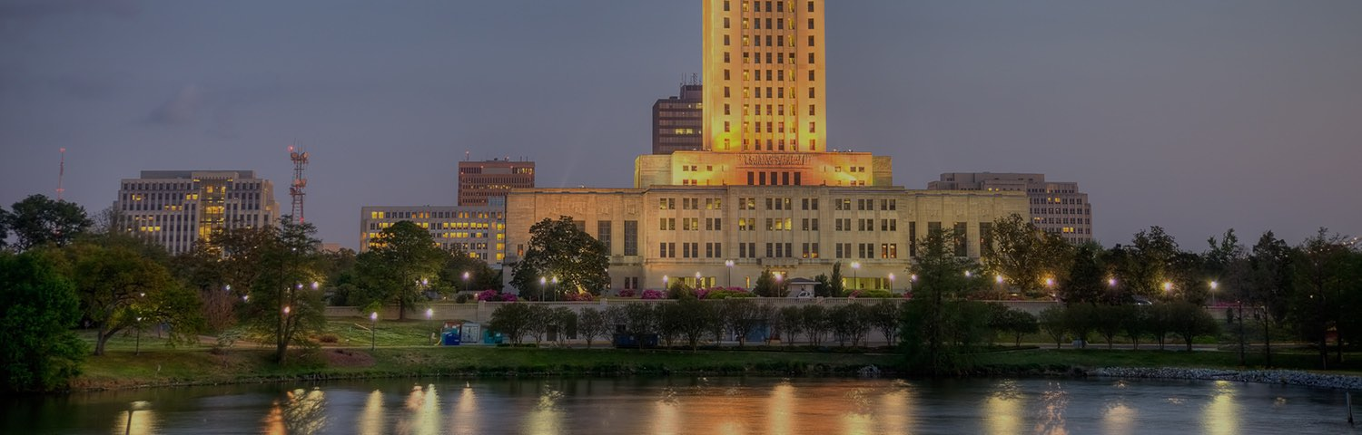 Crowne plaza baton rouge at night in front of a lake