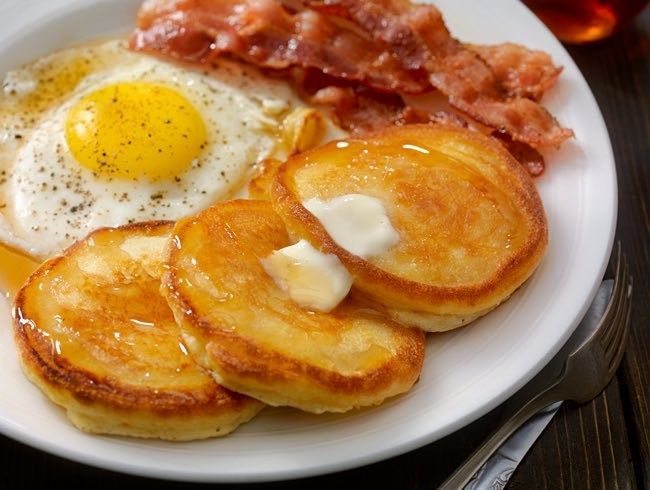 breakfast with eggs bacon and pancakes