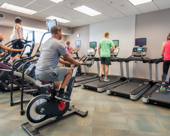 Group of people on cardio equipment