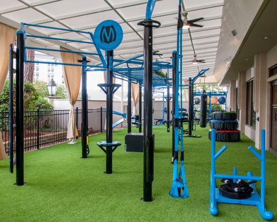 Outdoor fitness center with turf and equipment