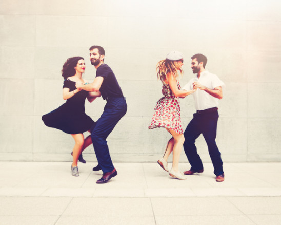 two couples dancing
