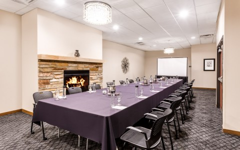 long table with a fireplace for meetings