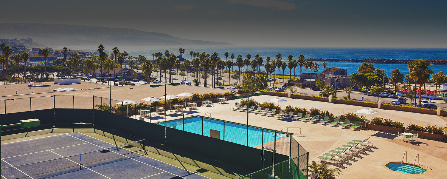 the pool deck and tennis courts