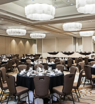 a ballroom with tables and chairs