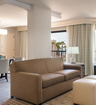 a living room inside of a hotel suite