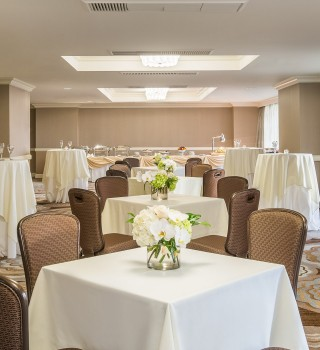 a ballroom with chairs and tables set for a reception