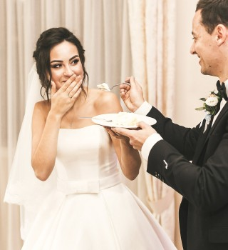 a couple eating cake at their wedding