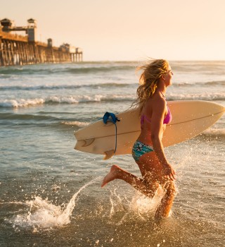 a woman with a surfboard